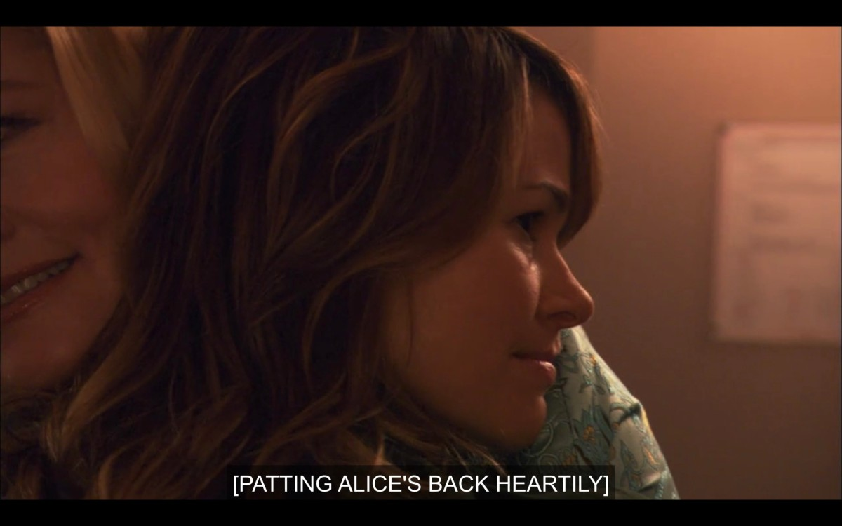 """Phyllis and Alice hugging. Alice's head is on Phyllis's shoulder. Subtitles read, """"[Patting Alice's back heartily.]"""""""