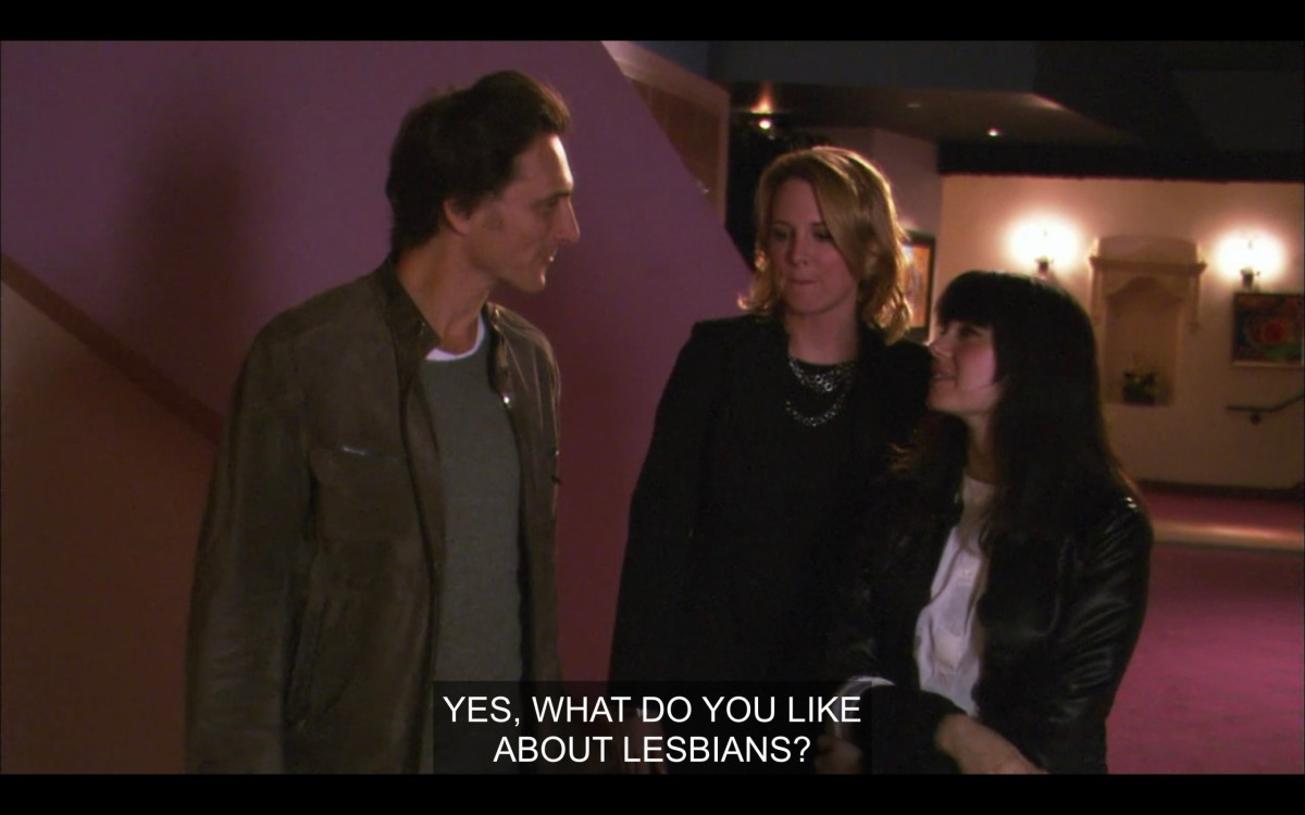 """Tina and Jenny talking to a white guy with short brown hair. Jenny says, """"Yes, what do you like about lesbians?"""""""