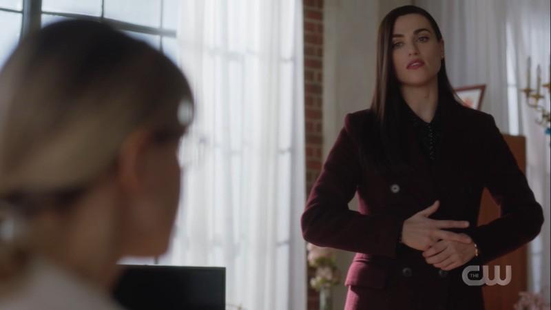 Lena wrings her hand nervously