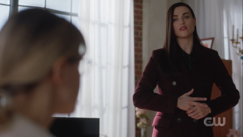 Lena wrings her hand nervously