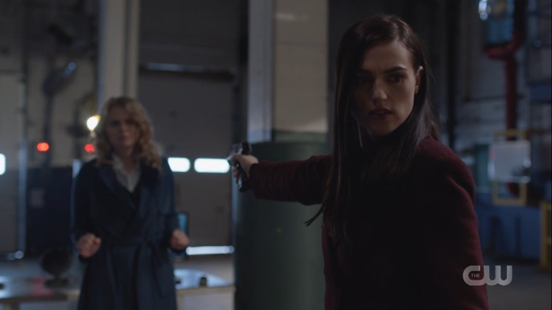 lena holds a gun to eve while supporting kara