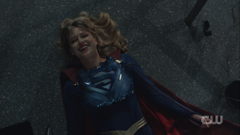 kara smiles as the suit materializes