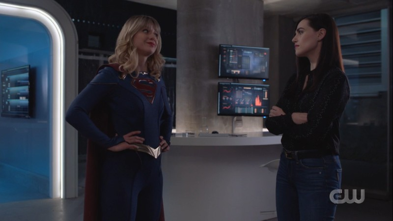 Supergirl and Lena exchange a look