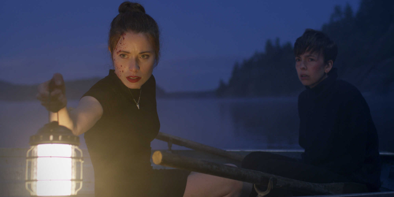 what keeps you alive film still: two women in a boat on a dark night