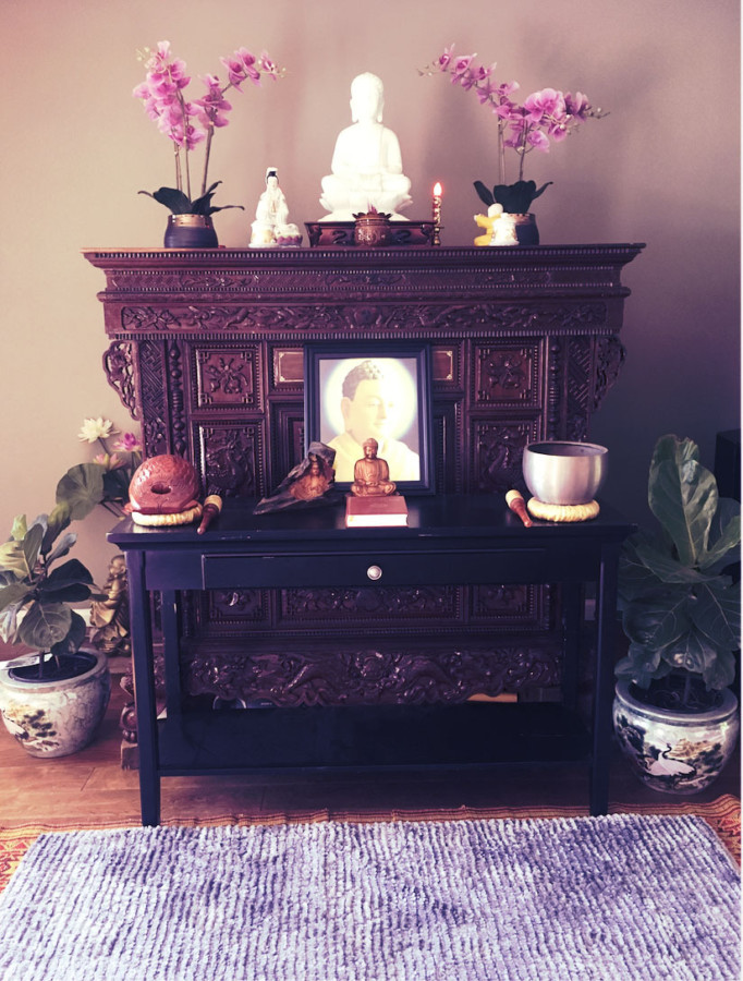 The family shrine, adorned with orchids, incense, and meditation bowls.