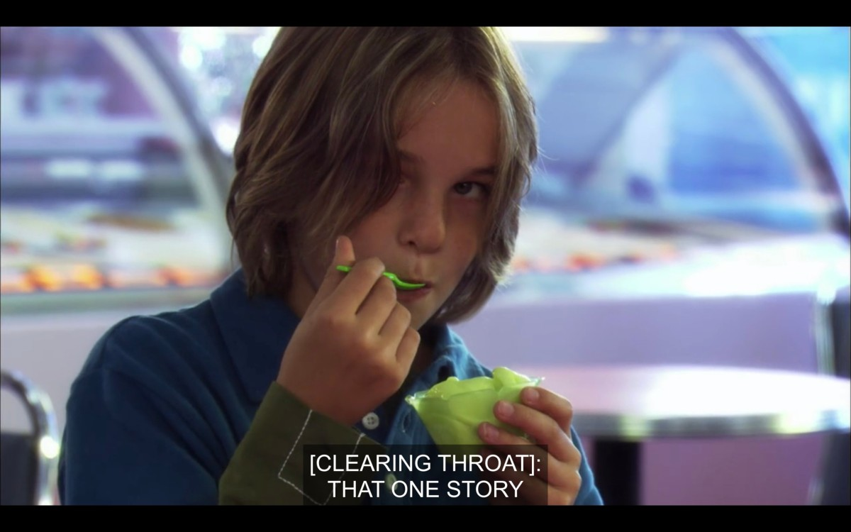 "Jared is wearing a blue shirt and eating green ice cream with a green spoon. ""[Clearing throat]: That one story"""