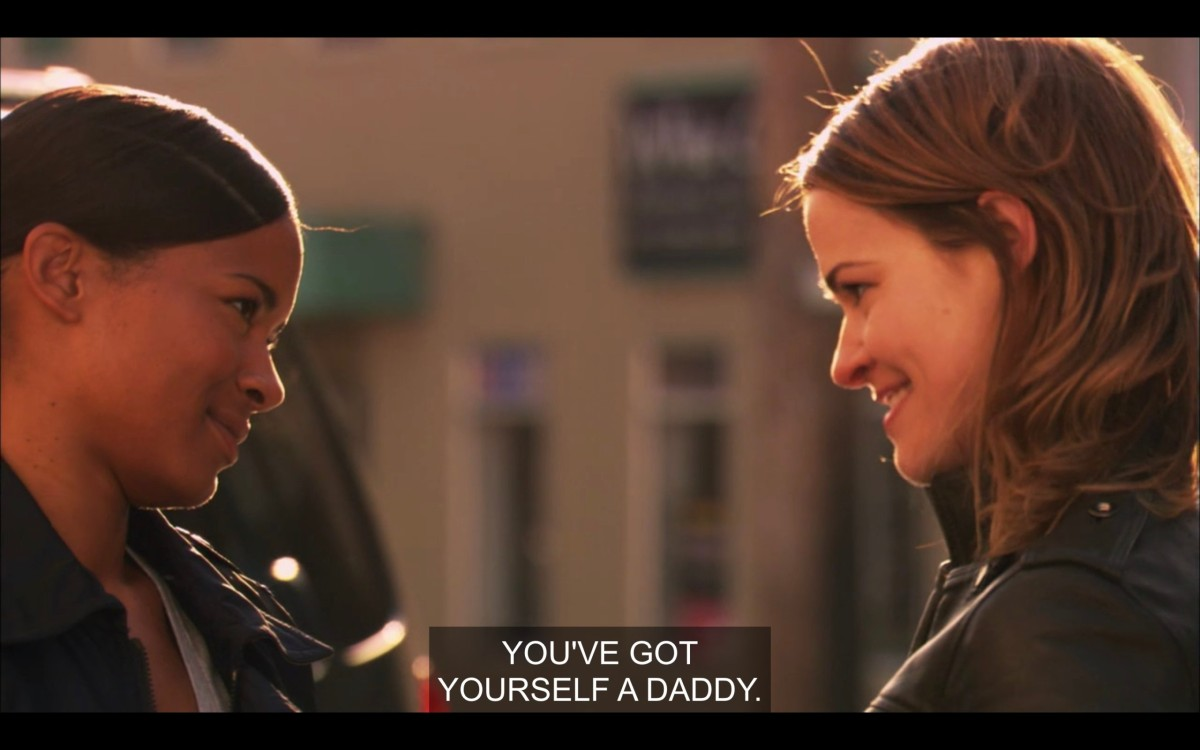"""Tasha and Alice stand facing each other and smiling like they're in love. """"You've got yourself a daddy."""""""