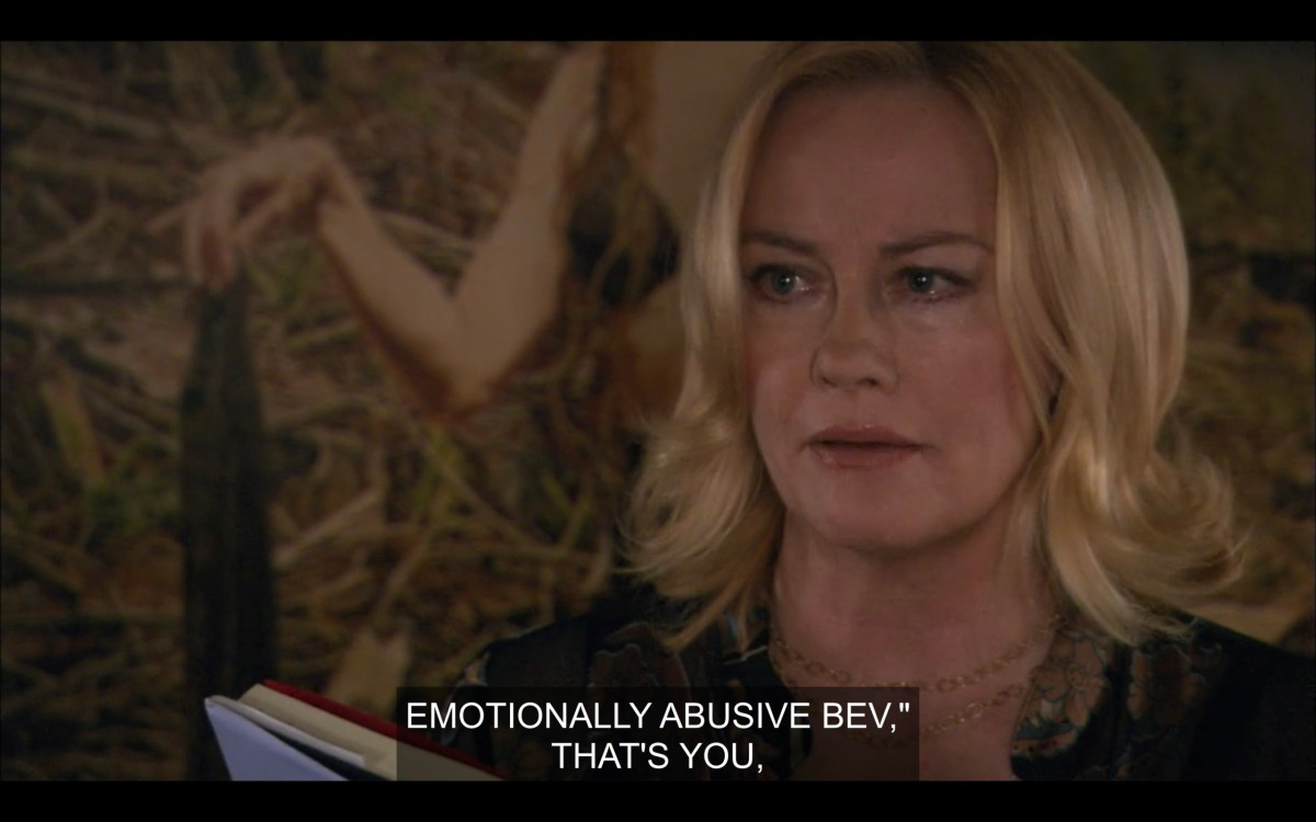 """Phyllis, in a black blazer, reading from Lez Girls. She says, """"Emotionally abusive Bev, that's you."""""""