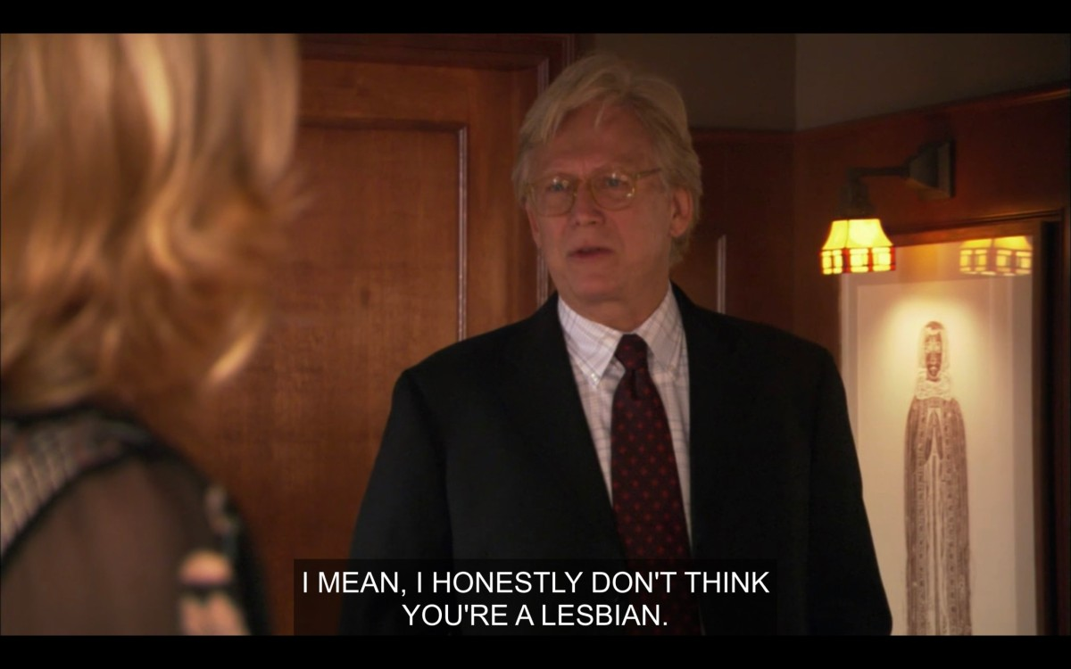 """Phyllis's husband says to Phyllis (whose back is to the camera), """"I mean, I honestly don't think you're a lesbian."""""""