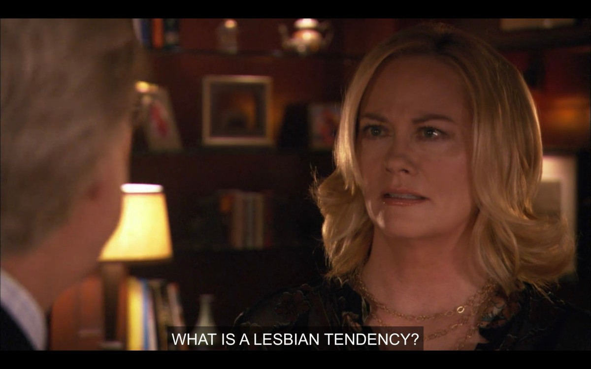 """Phyllis stares back at her husband (whose back is to the camera) and says, """"What is a lesbian tendency?"""""""