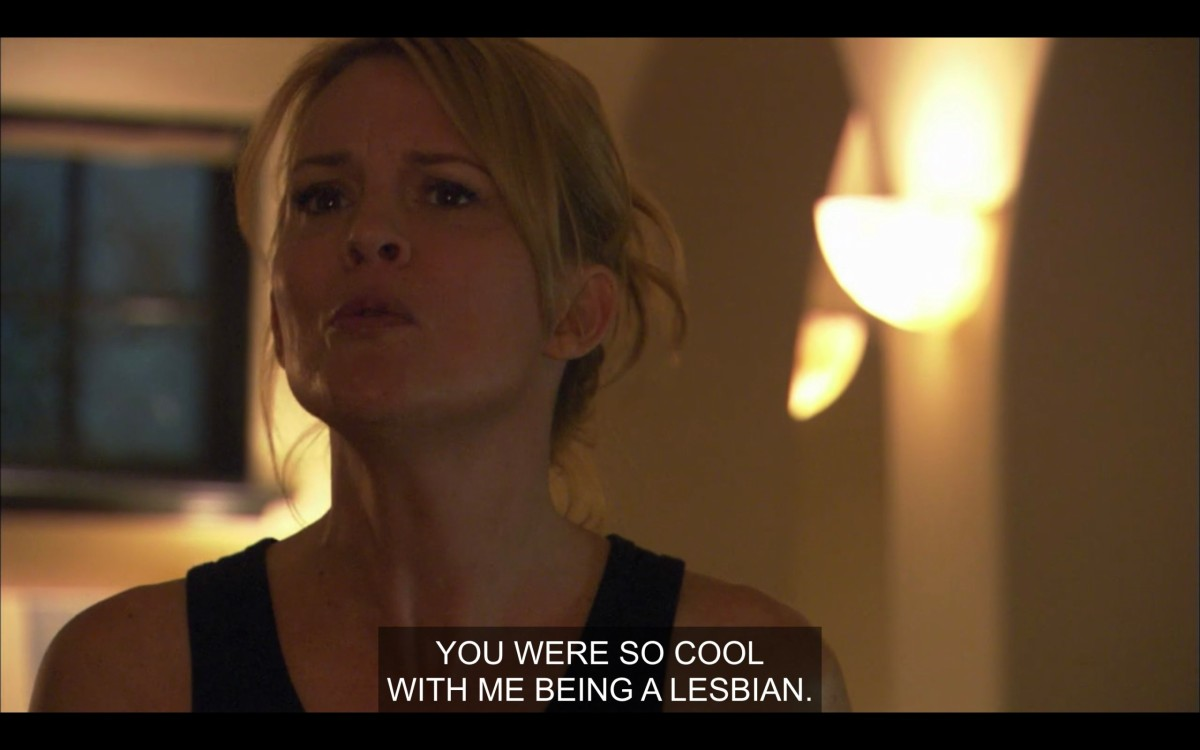 """Tina in the kitchen, saying to Henry (off camera), """"You were so cool with me being a lesbian."""""""