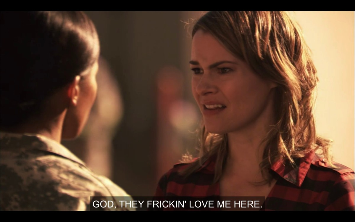 """Alice (wearing a red and black flannel shirt) and Tasha (in her army uniform) facing each other. Alice says, """"God, they friction' love me here."""""""