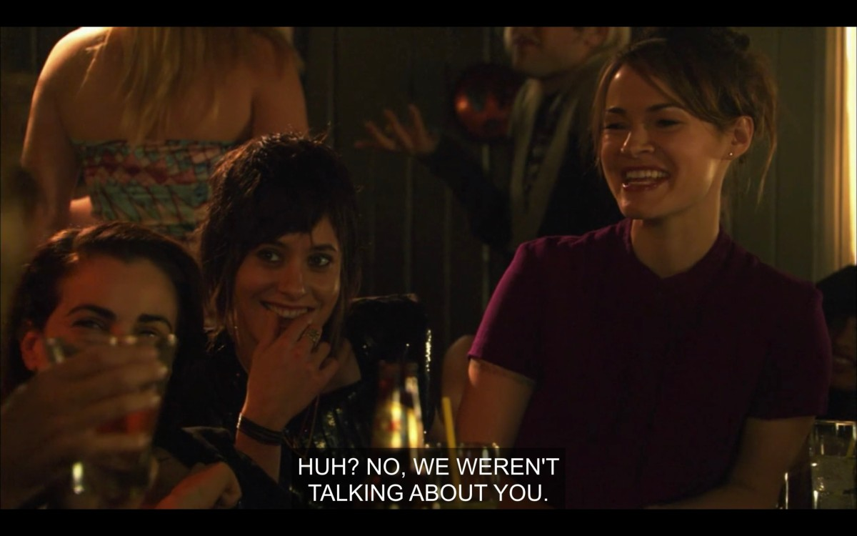 """Jenny, Shane, and Alice laughing together at a dimly lit bar. """"Huh? No, we weren't talking about you."""""""
