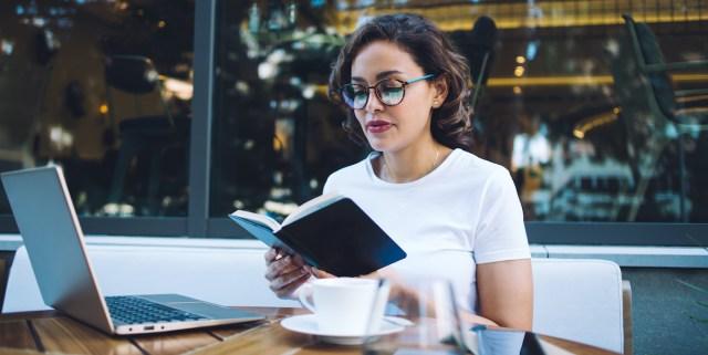 a woman reading outside