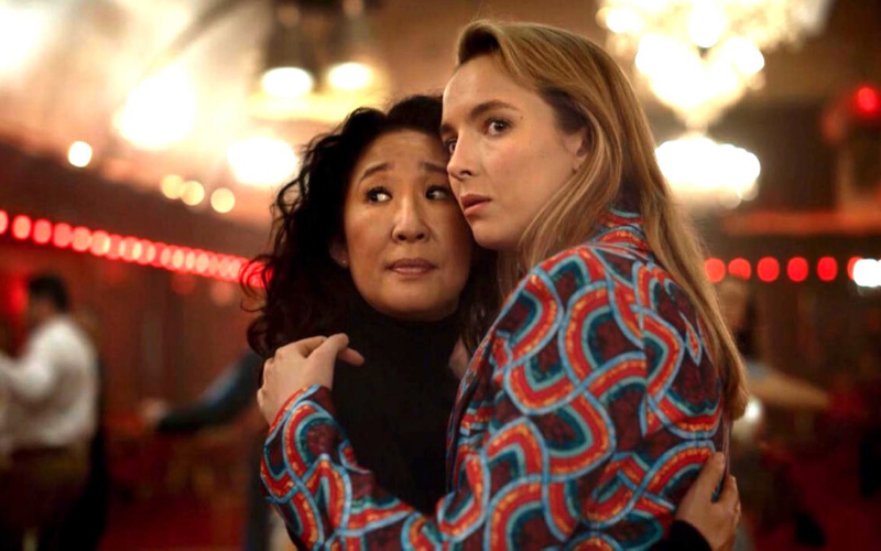Actress Jodie Comer holds actress Sandra Oh