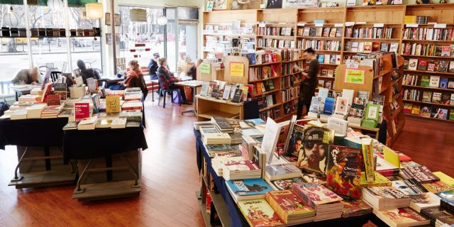 A wide angle photo of the inside of Bluestockings bookstore and activist center.