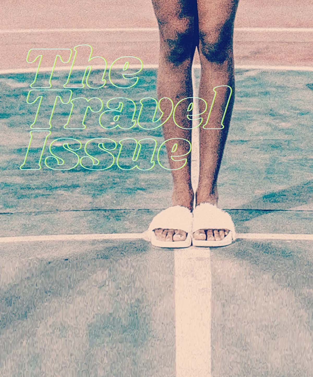 the travel issue [image is legs in slippers standing in tennis court]