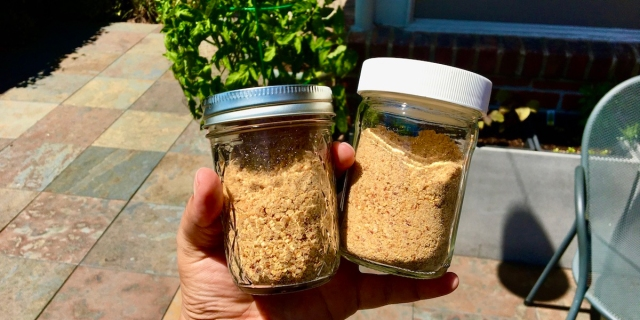 Image of two mason jars filled with a homemade South Indian spice mixture known as gunpowder (otherwise known as molaha podi).