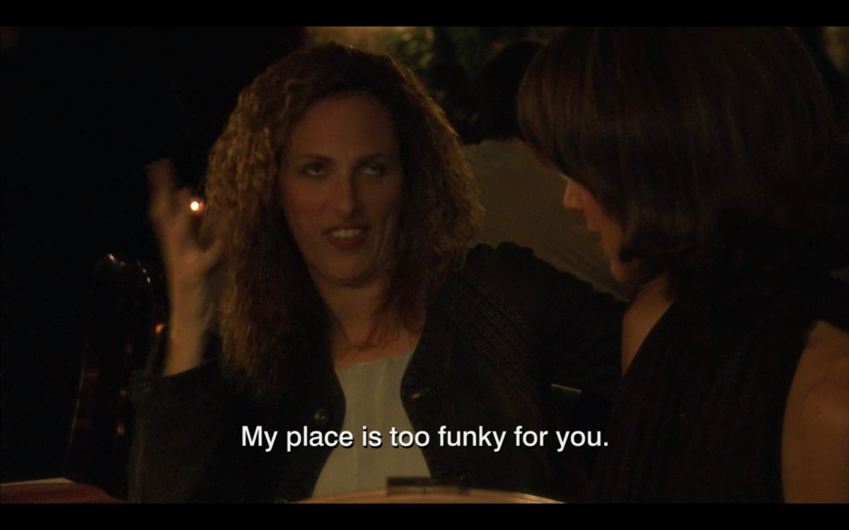 """Jodi saying """"My place is too funky for you"""" to Bette in a restaurant"""