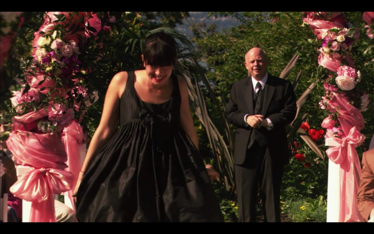 Jenny arriving at the wedding, wearing her garbage bag dress and running down the aisle.