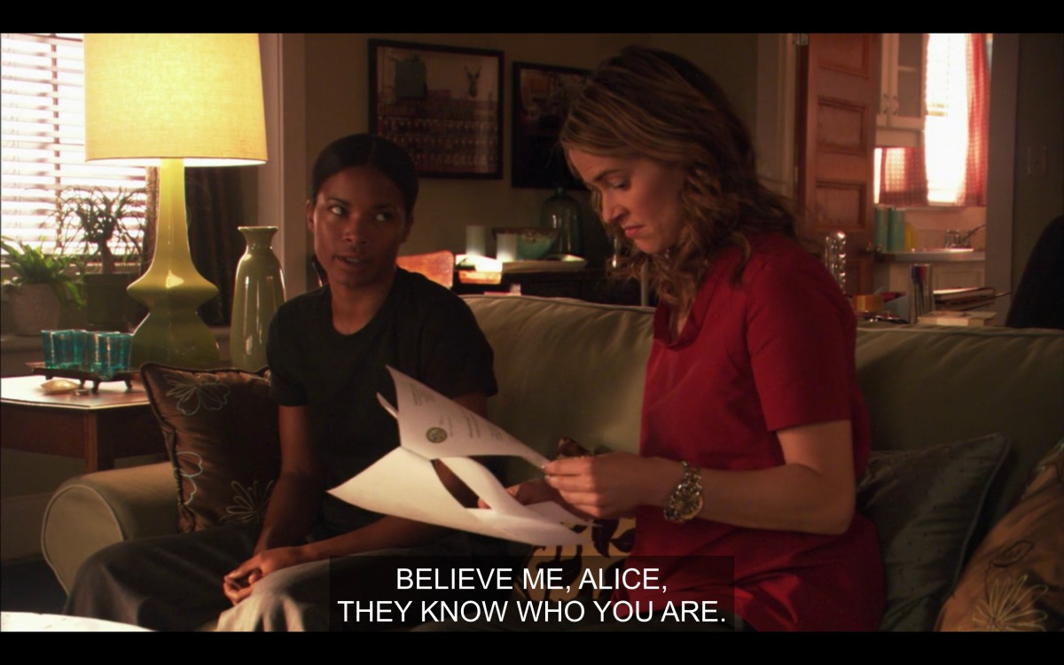 """Tasha and Alice sitting on Alice's couch, Alice reading the report on Tasha'a homosexual conduct. Caption says """"believe me, Alice, they know who you are."""""""