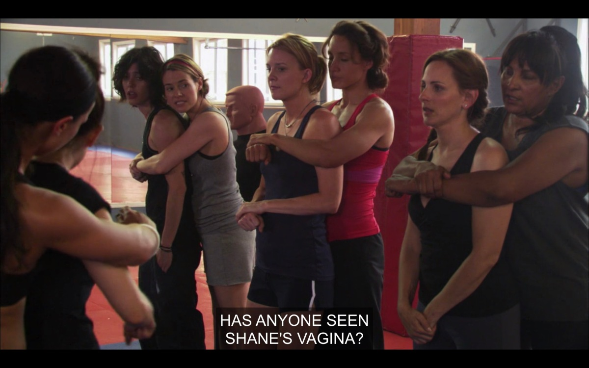 """The L Word girls at self-defense class, practicing holds. Alice is asking the group """"Has anyone seen Shane's vagina?"""""""