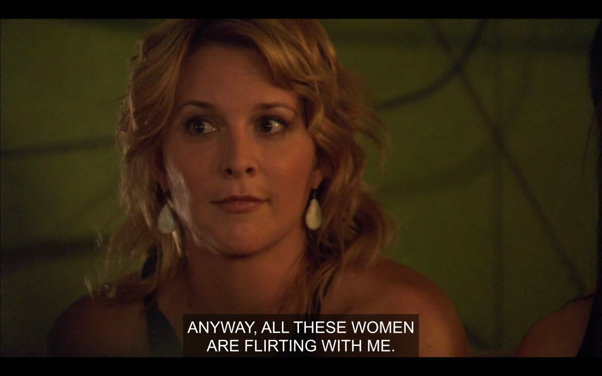 """Tina with a dubious facial expression, listening to Phyllis say """"anyway, all these women are flirting with me."""""""