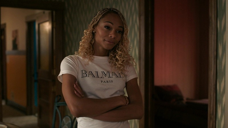 Imani folds her arms as she tries to teach Jake a lesson about responsibility.