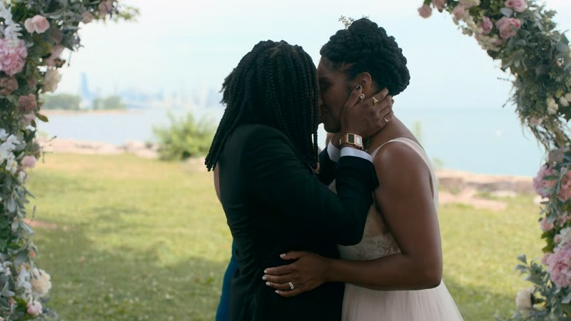 Nina and Dre cement their wedding vows with a kiss.
