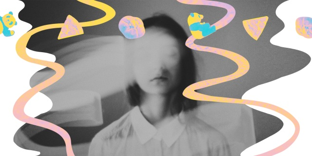 hazy image of woman closing her eyes, rainbow objects fly around her face