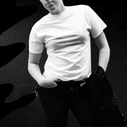 butch with hand in pocket, black background