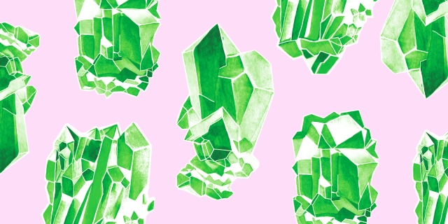 green watercolor crystals on a pink background