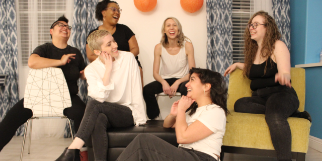 The team shares a giggle together. From left to right, Kamala, Laneia, Carmen, Riese, Sarah and Rachel all wear pretty darn happy expressions.