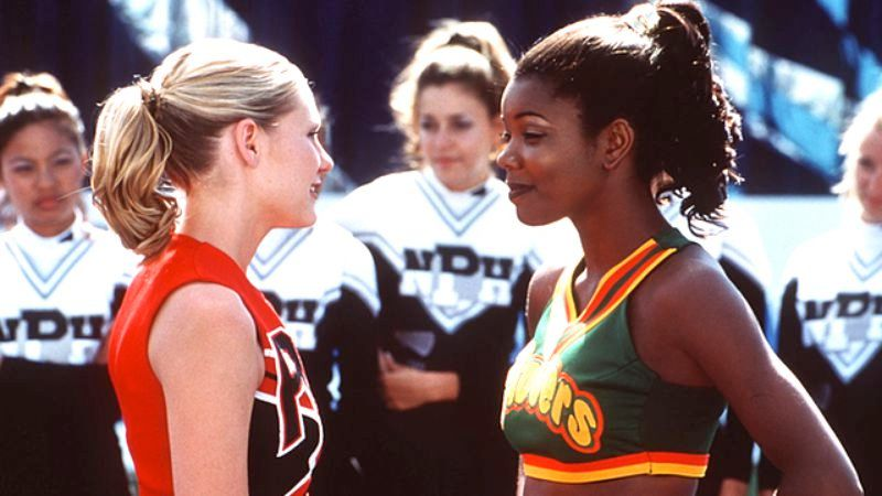 "Kristen Dunst facing off against Gabrielle Union in a still from the movie ""Bring It On"""