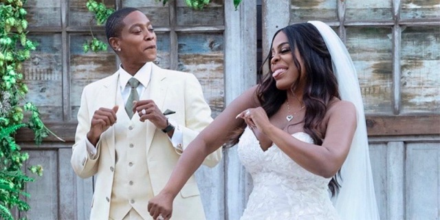Niecy Nash and her wife Jessica Betts dancing together on their wedding day.