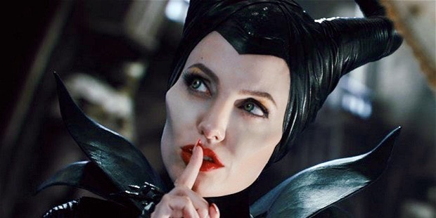 "A still of Angelina Jolie from the movie ""Maleficent."" She is holding her finger to her mouth, as if to say ""shhhhh"" because she knows the reason that snakes don't need men for anything."