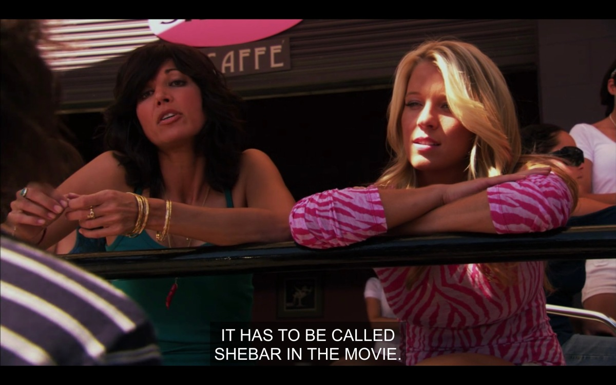 Dawn Denbo and her Lover Cindi are leaning on the railing at SheBar telling shane that they want their bar to be in the movie