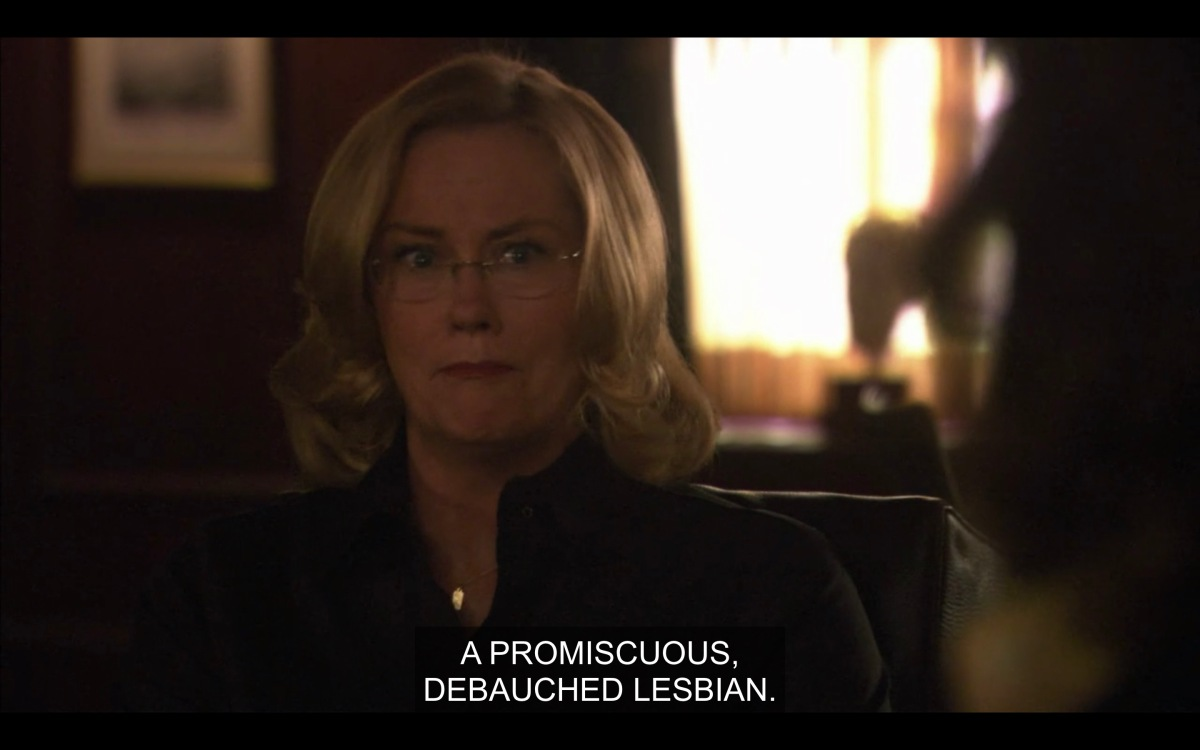 """Phyllis in her office, caption reads """"A promiscuous, debauched lesbian"""""""