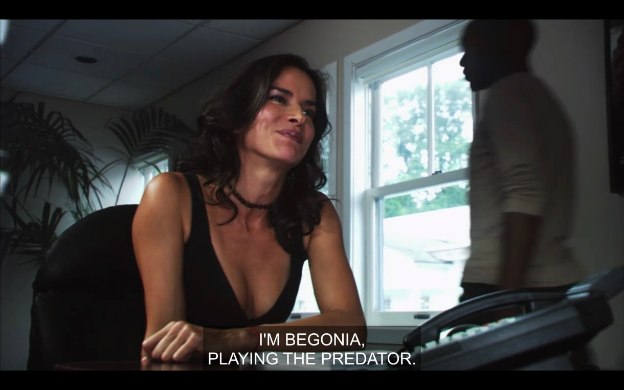 "Actress at a table reading for Lez Girls saying ""I'm Begonia, playing the predator."""