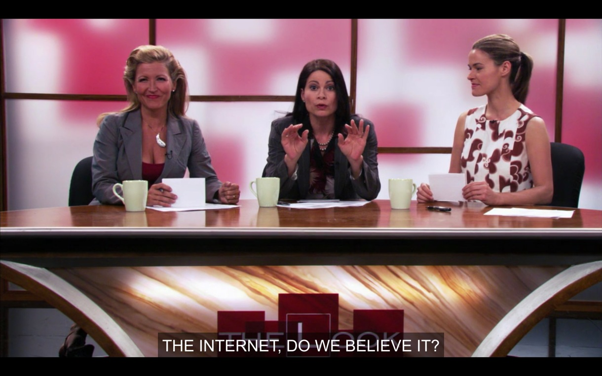 "The stage of ""The Look"" with two hosts and Alice. Asking ""the internet: do we believe it?"""