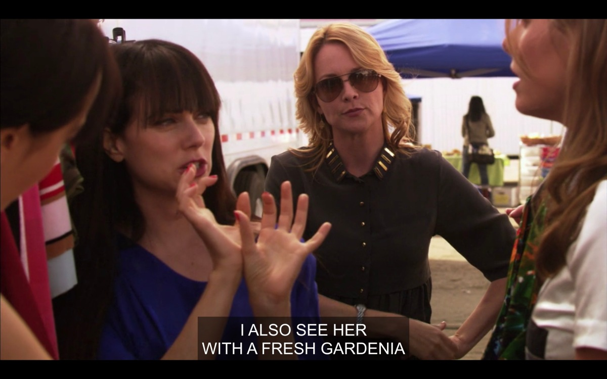 "Jenny talks about how she'd like a ""fresh gardenia"" on Karina's costume, while Tina stands behind her unimpressed"