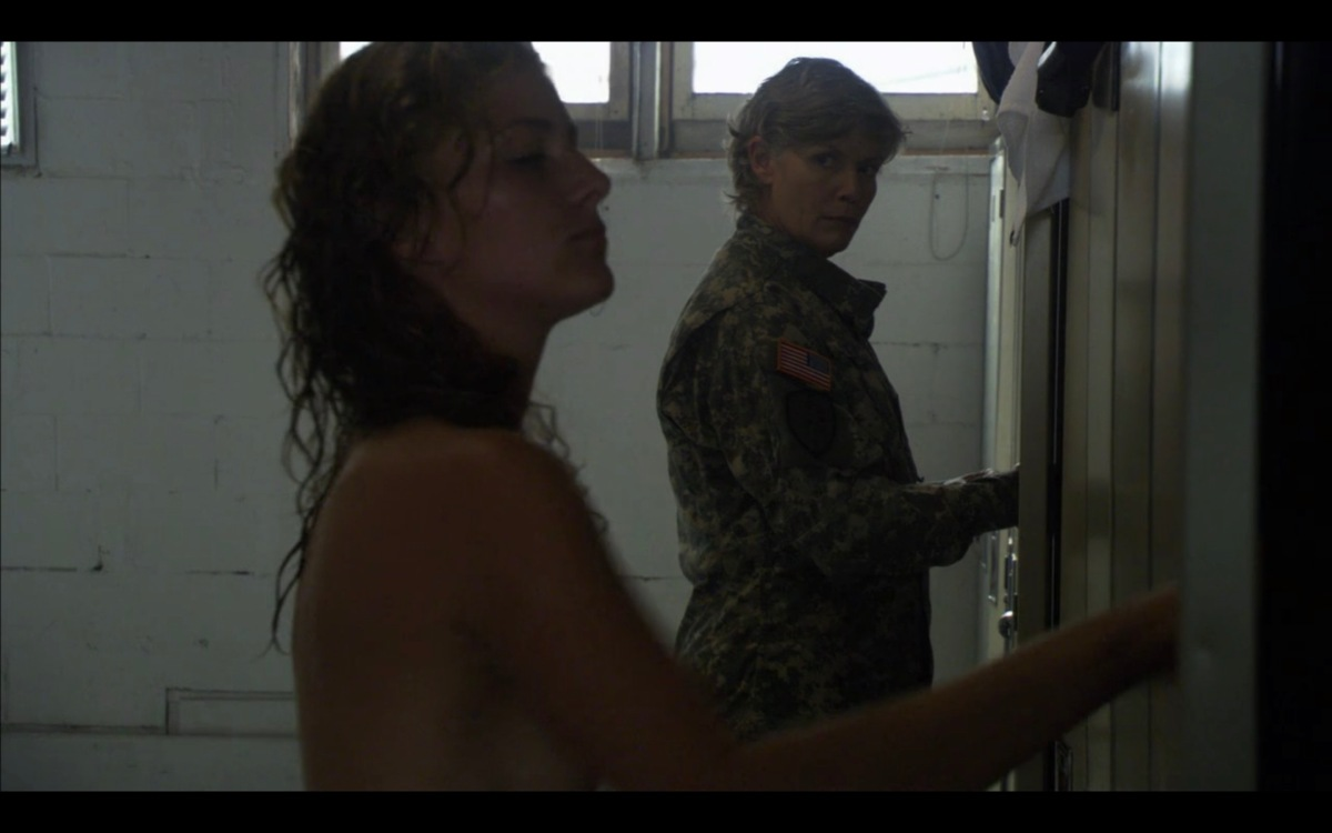 Colonel Davis checks out a naked woman in the locker room at Army