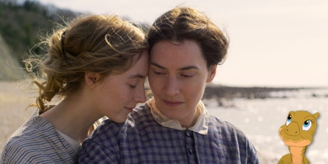 Kate Winslet and Saoirse Ronan canoodling in the film Ammonite. Ducky from The Land Before Time looks on adoringly.