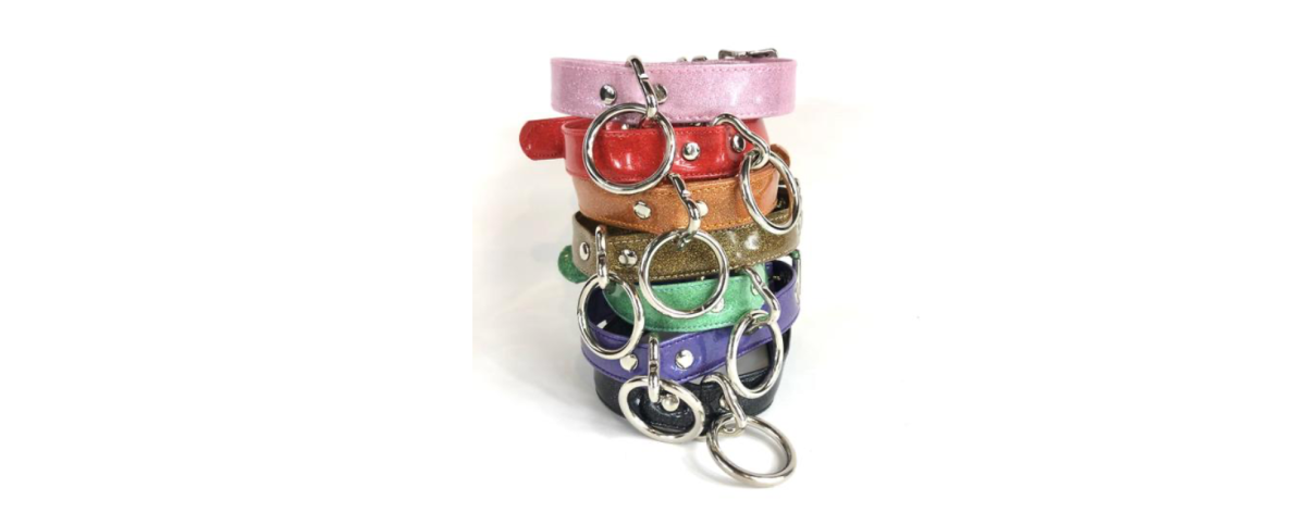 a stack of sparkly colorful vinyl collars with silver-colored hardware