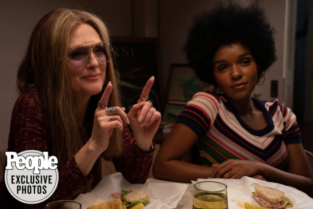 "Janelle Monae in an Afro as Dorothy Height sits at a table with Julianne More as Gloria Steinem, set in the 1970s from the upcoming film ""The Glorias."""