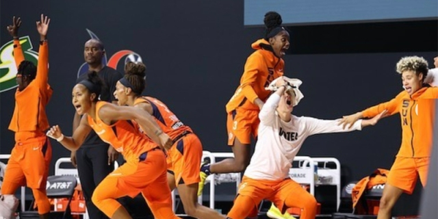 The Connecticut Sun celebrate their victory over the Las Vegas Aces in the WNBA semifinals.