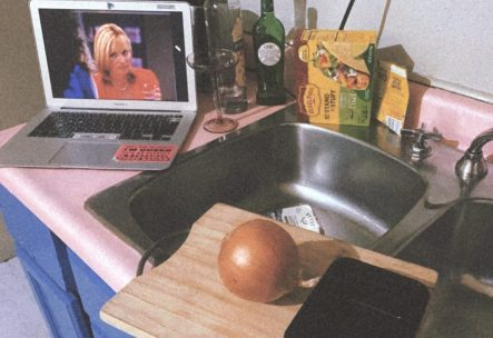 """Sex and the City"" plays on Shell's laptop in her kitchen, which has a pink countertop."