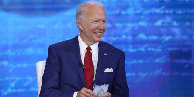 "Joe Biden shows off his mask during his town hall event, ""The Vice President and the People."""