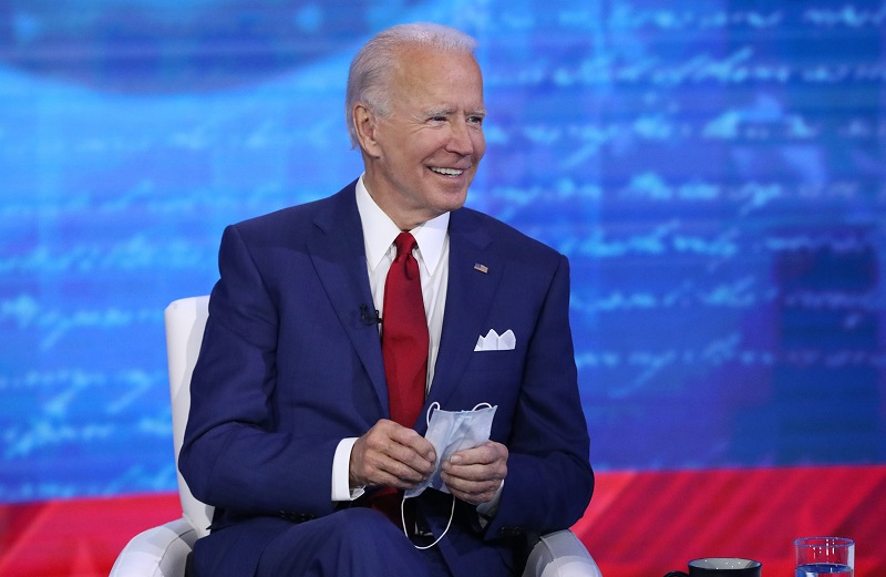 """Joe Biden shows off his mask during his town hall event, """"The Vice President and the People."""""""