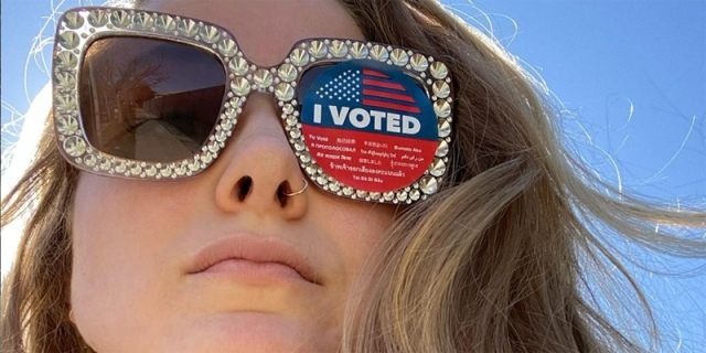 "Caroline Rose Giuliani has on blinged out sunglasses, one of the lenses is covered with an ""I Voted"" sticker."
